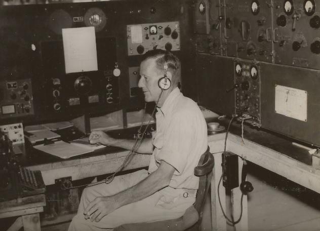 AWA Radio Operator at HQ Port Moresby. He had a slightly bigger radio!